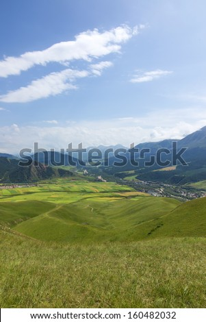 Mountains pastoral landscape in China Qilian, Eastern Switzerland - stock photo