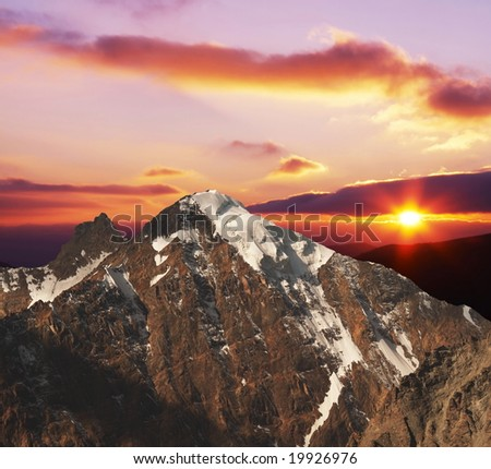 Mountains peak on sunrise