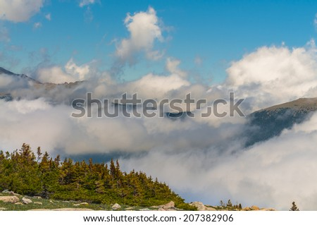 Mountains Peaks Covered by thick clouds Rocky Mountains National Park Landscape - stock photo