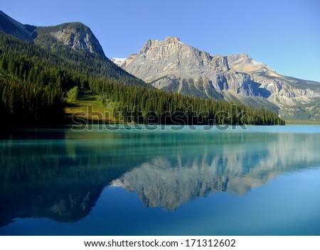 Mountains reflected in Emerald Lake, Yoho National Park, British Columbia, Canada - stock photo