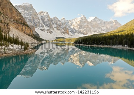 Mountains reflected in Moraine Lake Banff National Park Alberta Canada - stock photo