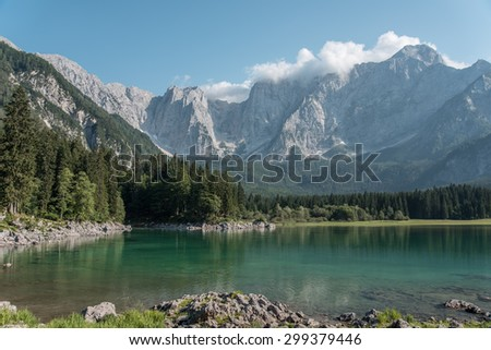 Mountains reflected in the enchanting of Lake Superior Fusine - Friuli