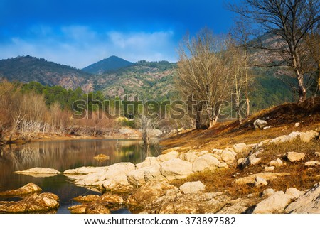 mountains river with forest riverside in winter day.  Muga, Catalan Pyrenees. Spain