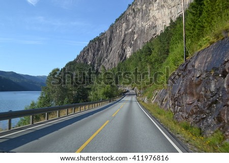 Mountains road by fjord in Norway