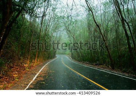 Mountains roads On a rainy day, Roads in the mountains of northern, Thailand, Beautiful mountains roads, Travelers challenging roads,beautiful roads,long way,rainy day  - stock photo