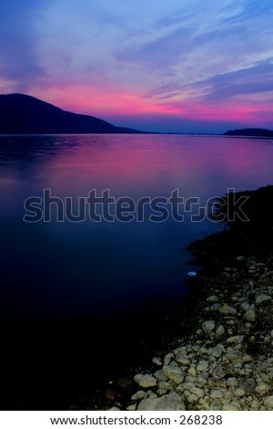 Mountains rocks and a water reflection - stock photo