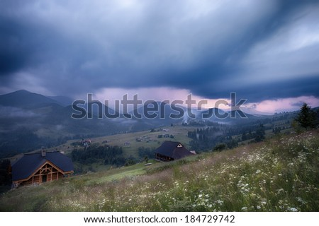 Mountains rural landscape in thunderstorm. Carpathian mountains, Ukraine - stock photo