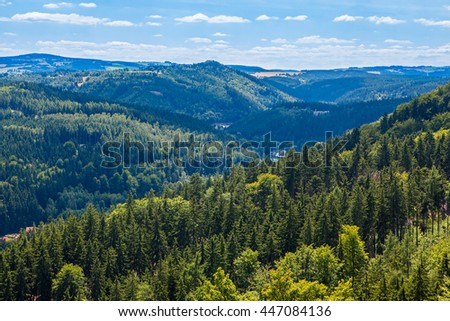 Mountains scenery. Panorama of grassland and forest - stock photo