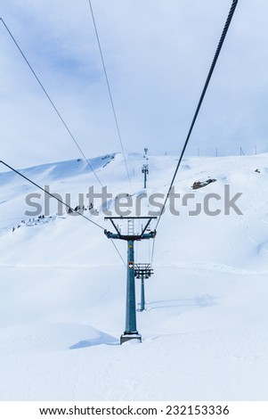 Mountains ski resort. Cable car. Winter in the swiss alps. mountain lift (funicular) - stock photo