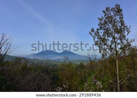 Mountains surrounding Kawah Ijen volcanic crater - stock photo