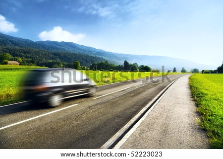 Mountains travel. Road with left driving. - stock photo