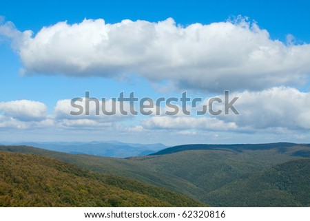Mountains with and a blue sky with white clouds - stock photo