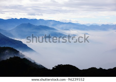 mountains with trees and fog in monochrome color shot in taiwan asian - stock photo