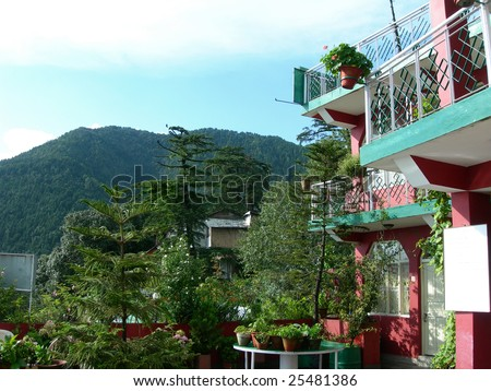 Mountainside village at the base of the Himalayas, India - stock photo