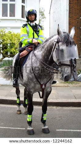 Mounted police woman - stock photo