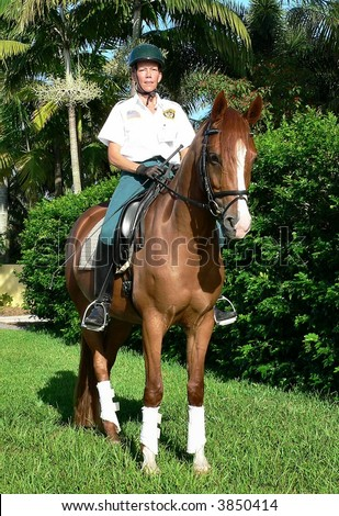 mounted policewoman on horseback