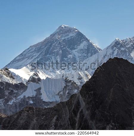 Mounts Everest (8848 m) and Lhotse (8516 m) from the Ngozumba Tsho (the fifth Gokyo lake) - Nepal, Himalayas - stock photo