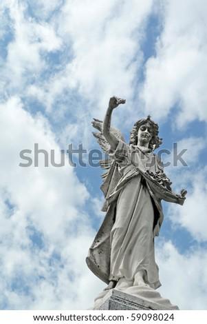 Mournful nineteenth century angel cemetery statue - stock photo