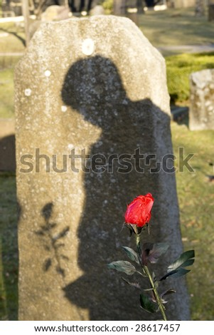 mourning by the grave - stock photo