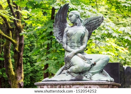 Mourning naked angel in the main cemetery of Zagreb - stock photo