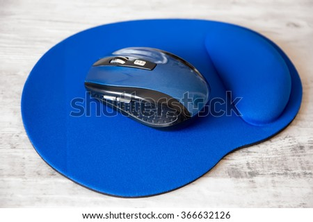 mouse pad on a retro background - stock photo