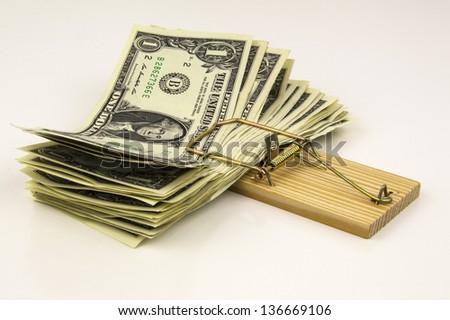 mouse trap full of dollar bills - stock photo