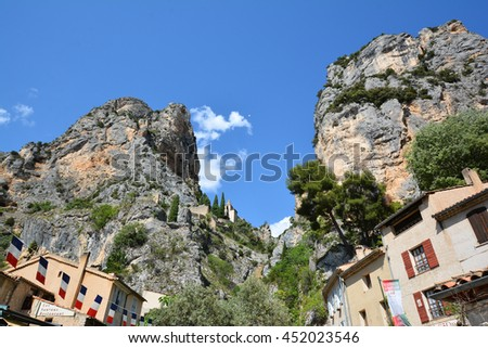 MOUSTIERES, FRANCE - JUNE 27, 2016 -  wonderful perched village is in the middle of two majestic rocky cliffs crossed by a lively mountain stream in the south of france provence