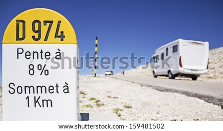 Mout Ventoux, milestone with motorhome, rv in france. - stock photo