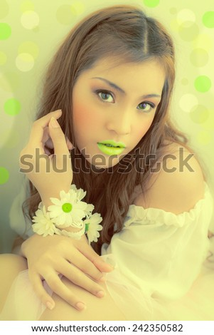 Mouth Lime Asian fashion.   Hand with flowers bokeh Professional makeup. Luxurious green bokeh .,LEMON-GREEN , young woman with flowers in their hand - stock photo