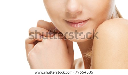 Mouth of beautiful young woman with naked shoulders, on isolated white background.