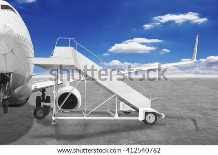 Movable boarding ramp near the entrance to the passenger airplane - stock photo