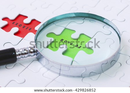 MOVE ONAND  EXCUSE  puzzle with magnifier glass - stock photo
