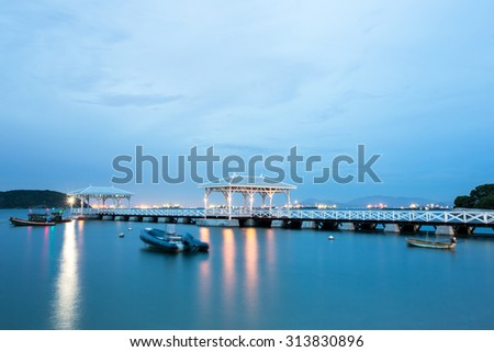 Movement during this long exposure. Twilight sky and bridge column in the sea with Sichang island.