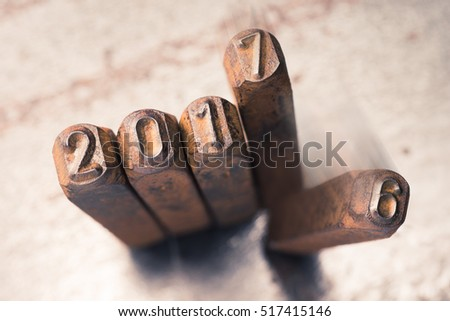 Movement of A.D. 2017 replace A.D. 2016 new year concept, The number made from reverse photo of old metal alphabet stamp punch