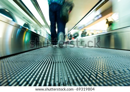 movement of abstract escalator with people - stock photo