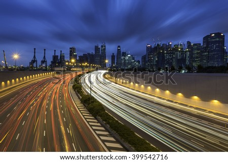Movement of car light with Singapore cityscape skyline during twilight - stock photo