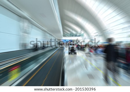 Movement of travellers in the airport - stock photo