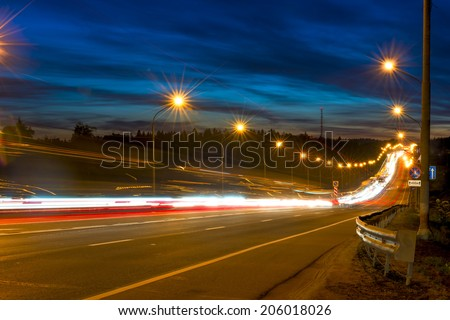 movement of vehicles on the highway at night - stock photo