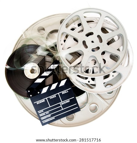 Movie clapper board and different cinema 35mm film reel isolated on white background - stock photo