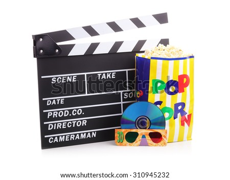 Movie clapper board, box of popcorn and a DVD disc with 3d glasses - stock photo