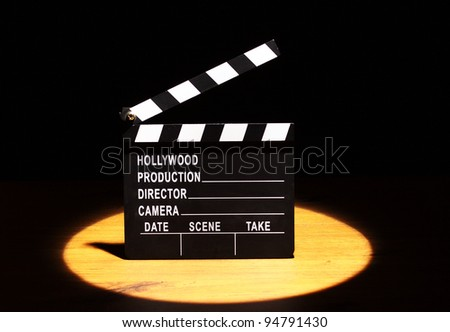 Movie clapper board under the spotlight - stock photo