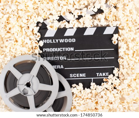 movie clapper board with popcorn - stock photo