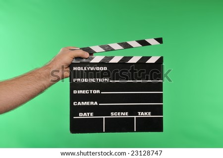 movie clapper on chroma green - stock photo