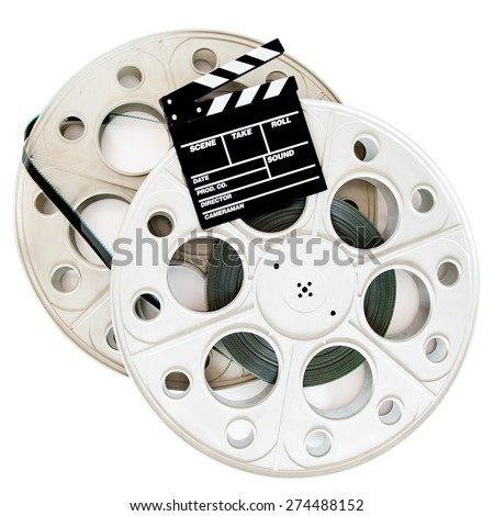 Movie clapper on two 35 mm cinema reels with film isolated on white background - stock photo