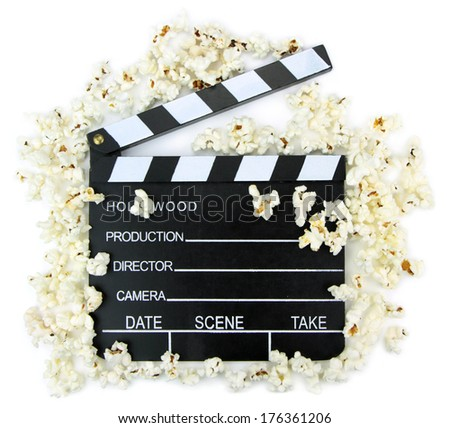 Movie clapper with popcorn - stock photo