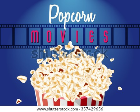 movie film reel and popcorn cinematography concept.  - stock photo