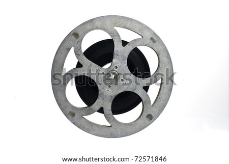 Movie film reel, partly filled; isolated on white ground - stock photo