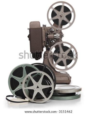 Movie film reels and vintage movie projector on white background - stock photo