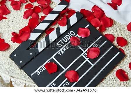Movie flapper with rose petals close-up - stock photo