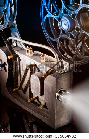 Movie projector with the film - stock photo